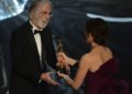Best Foreign Language Film winner Michael Haneke accepts his award from Jennifer Garner onstage at the 85th Annual Academy Awards on February 24, 2013 in Hollywood, California. AFP PHOTO/Robyn BECKROBYN BECK/AFP/Getty Images